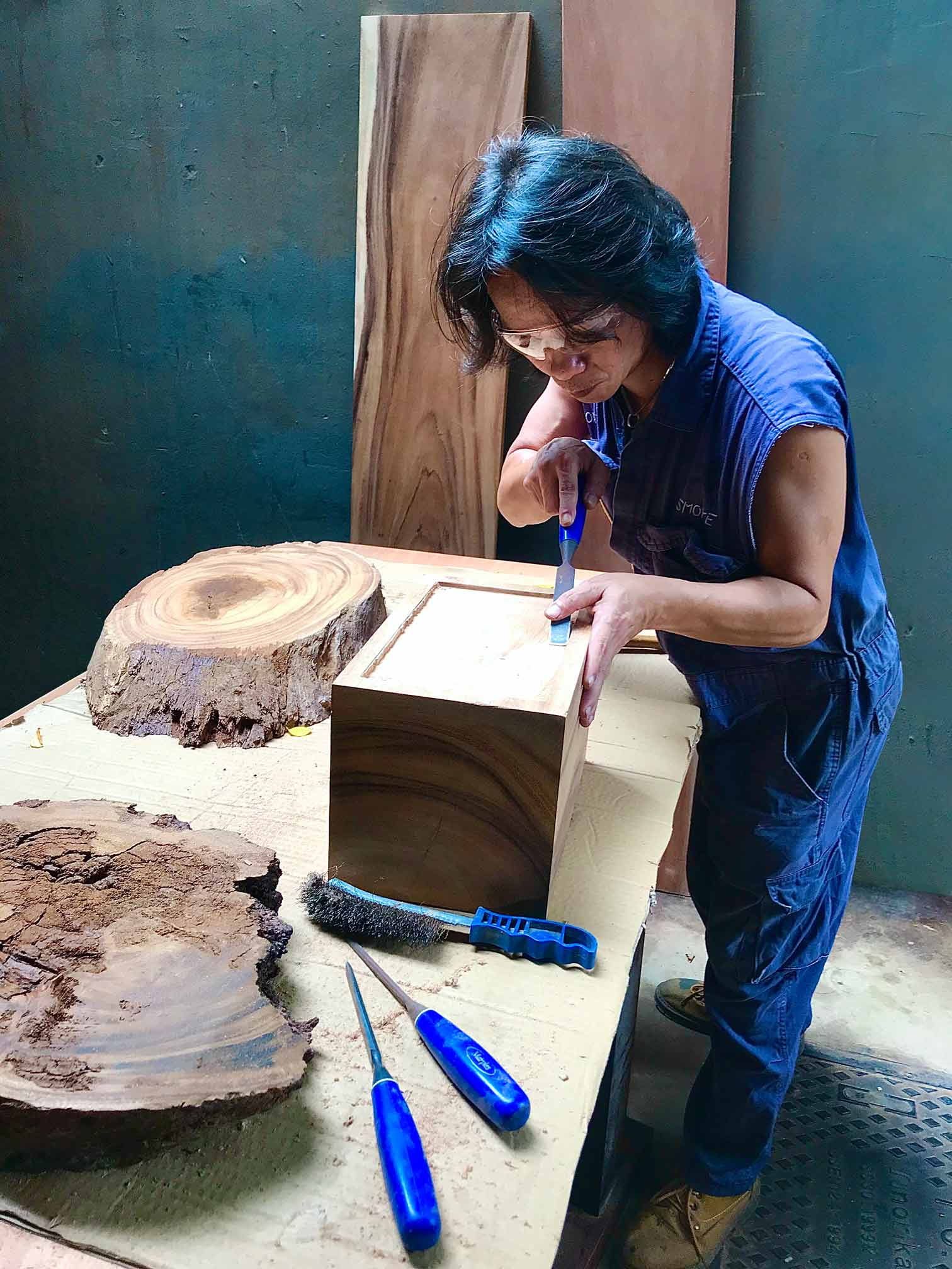 Handcrafted furniture Singapore - chiseling some wood