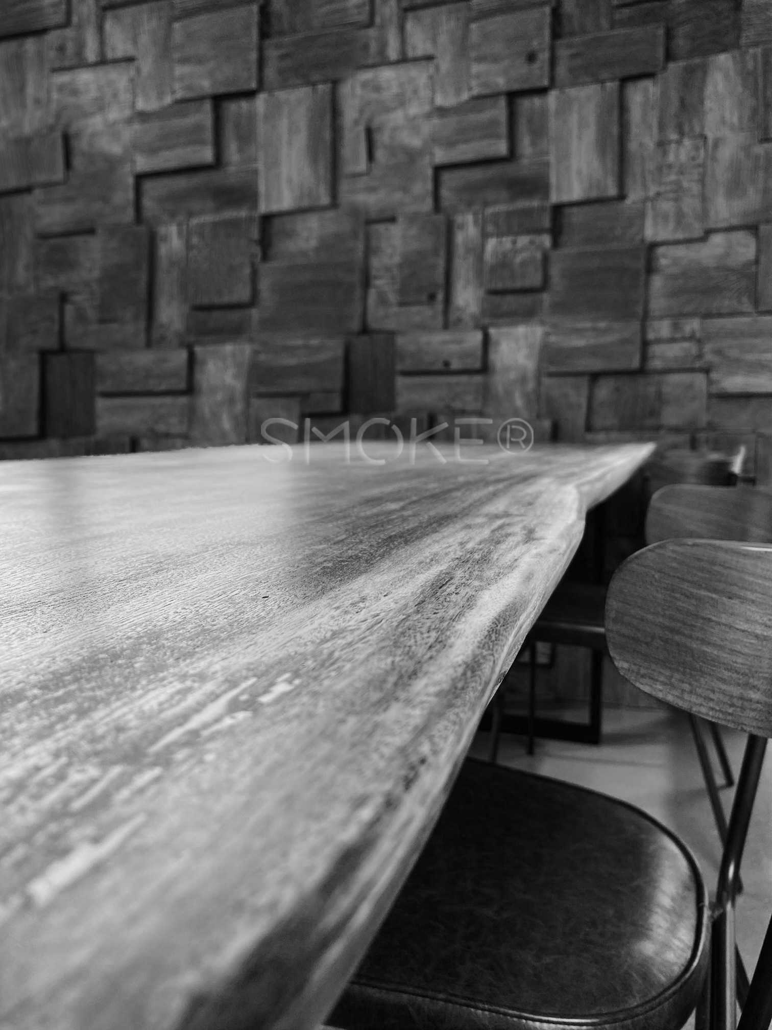 Wooden dining table feature wall